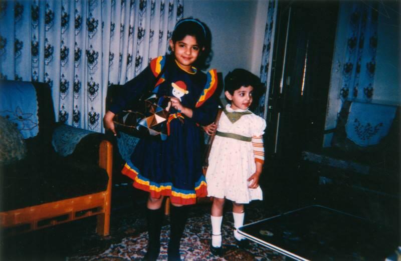Two young girls pose in modern Pakistani dress, circa 1991