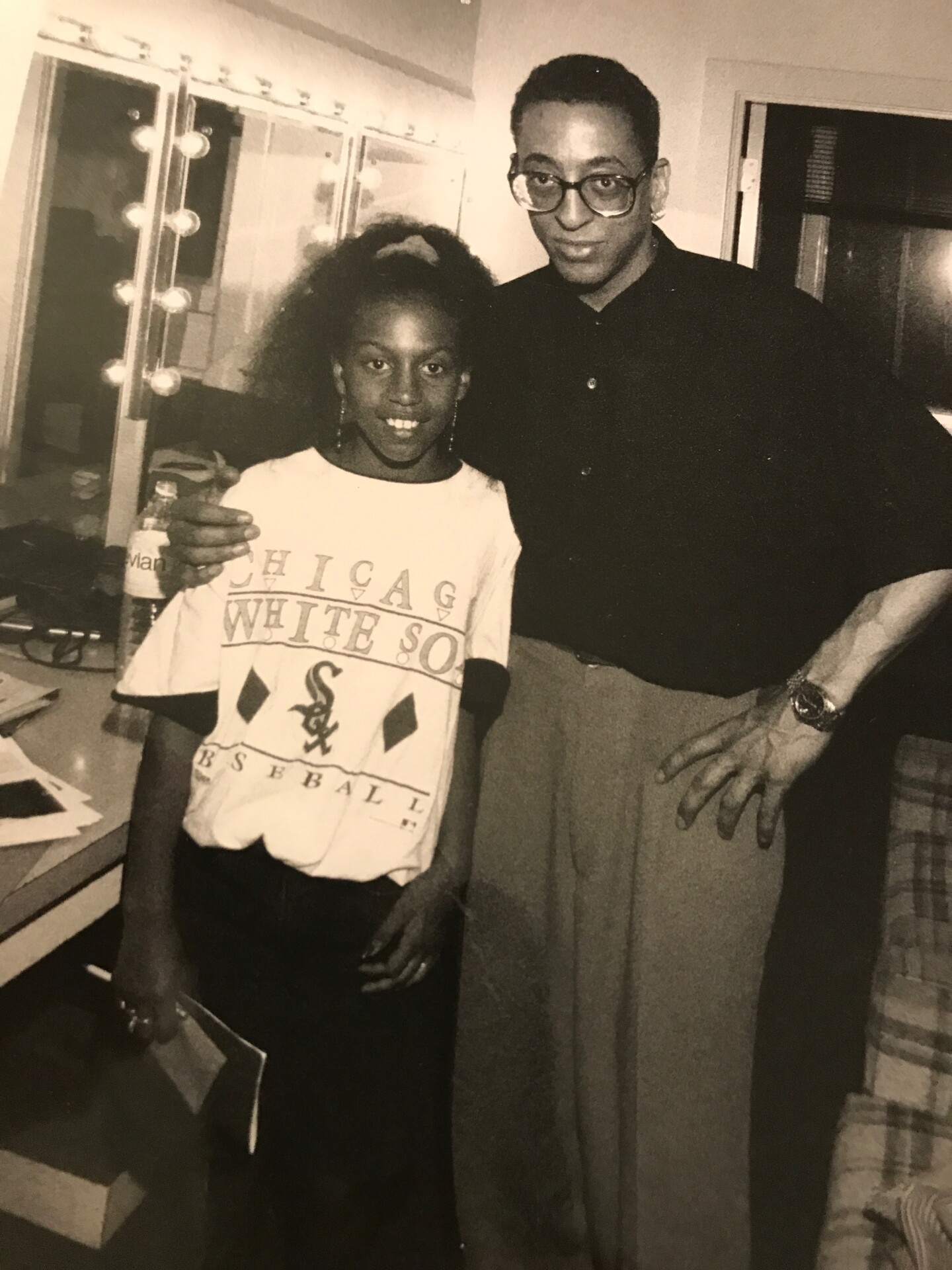 A young girl, dancer Chloe Arnold with Gregory Hines.