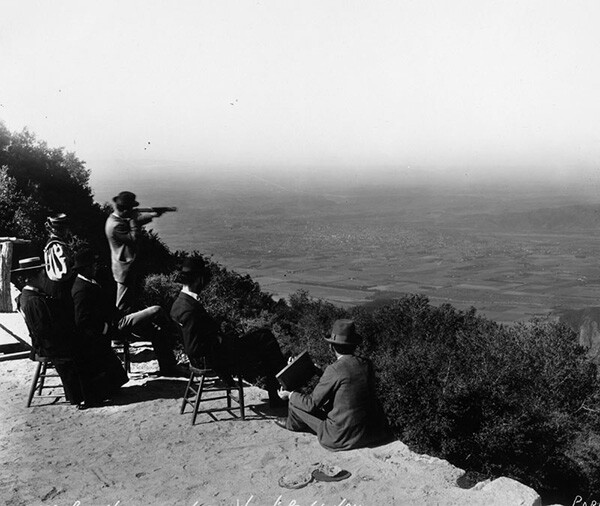 A group of people on the top of the mountain look at Pasadena from Martin's Camp, Wilson's Peak. | Courtesy of the Los Angeles Public Library