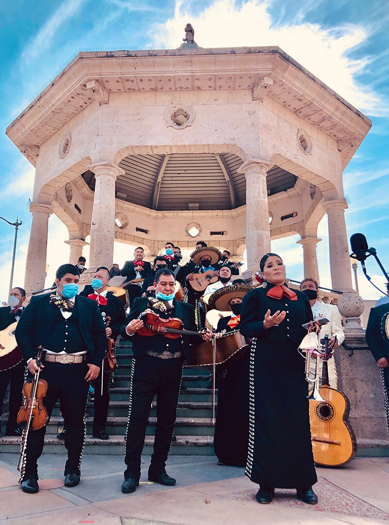 A mariachi group poses before aperformanceat Mariachi Plaza in Boyle Heights to fundraise for the mariachi relief fund. | Courtesy of Community Power Collective