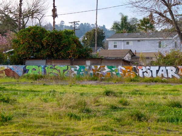 Graffiti has moved from the banks of the river into vacant lots.
