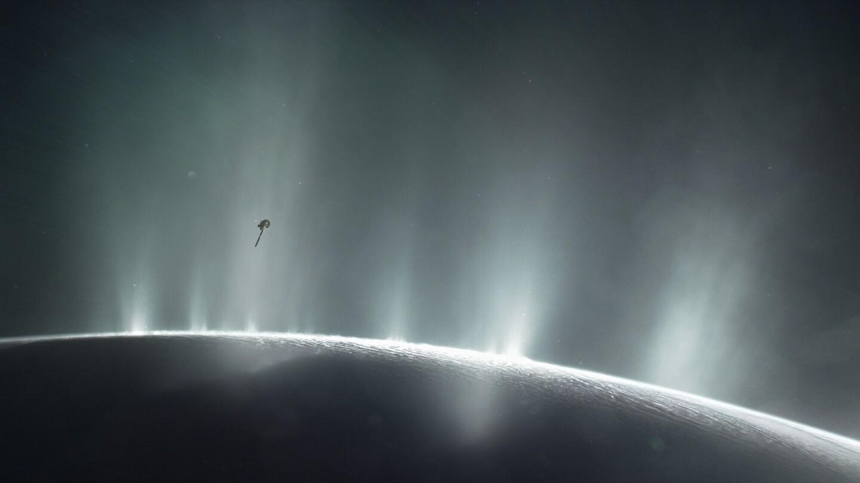 Artist's rendering shows Cassini diving through plume from Saturn's moon Enceladus.