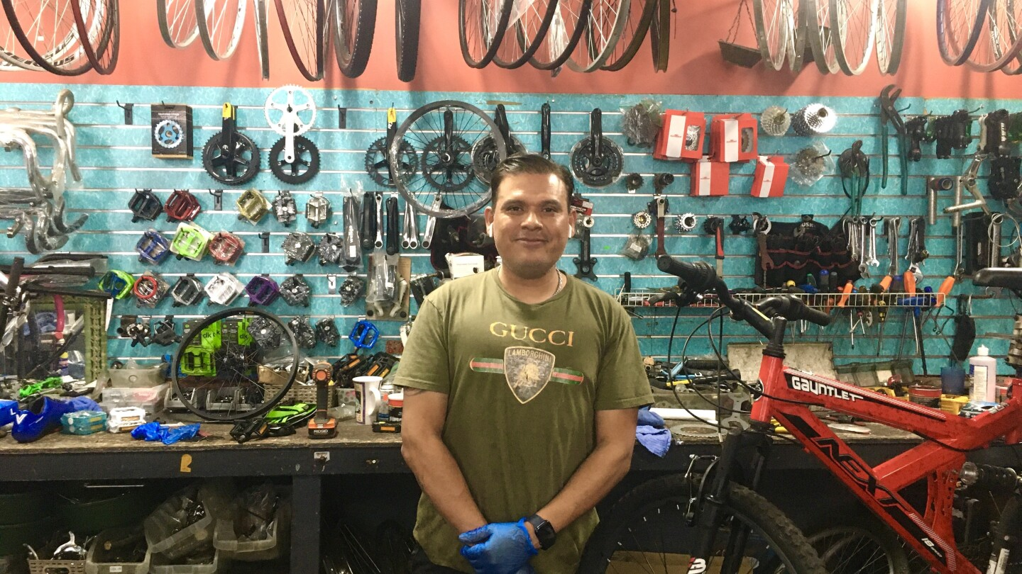 Nestor Lobo, owner of Retro Xpress Bicycles in Van Nuys, stands in front of his work station.