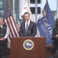 Governor Gavin Newsom at podium addressing COVID-19 on March 15th, 2020