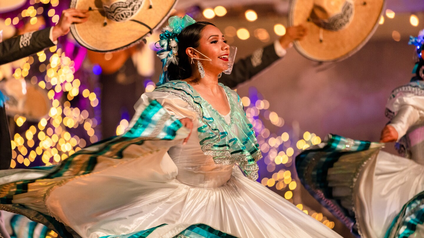 "A dancer from Ballet Folklorico de Los Angeles in the middle of a performance. | From ""The 61st Annual Los Angeles County Holiday Celebration"" 
