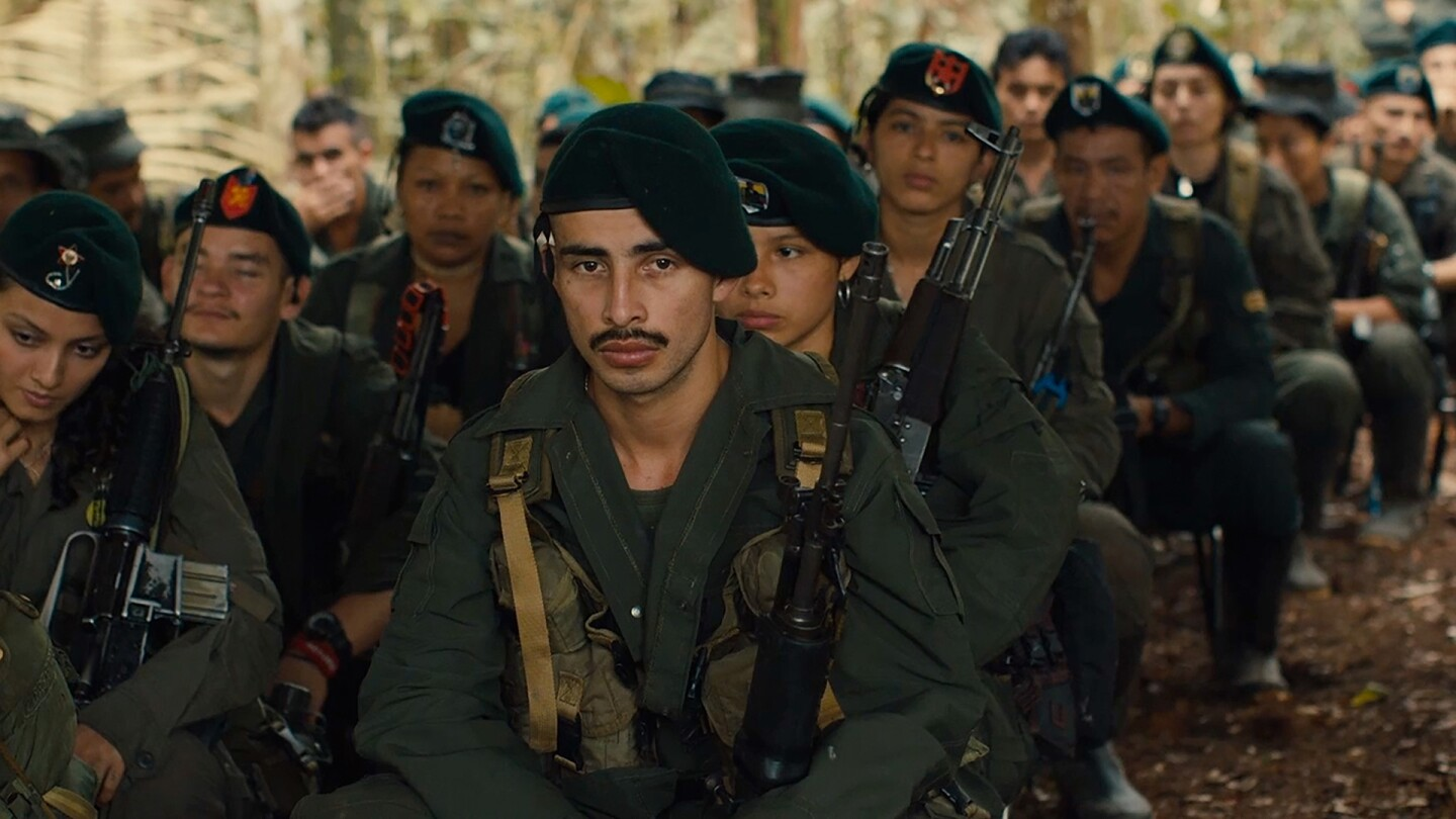 """Colombian soldiers sit in many rows. 