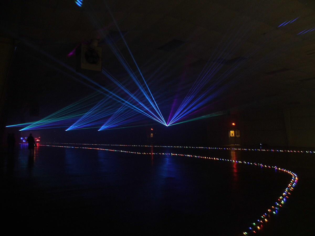 Blue and green lasers flash at Holidays In Your Car at the Ventura County Fairgrounds.   Sandi Hemmerlein