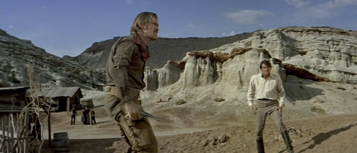 """Chuck Connors and Gregory Peck duel it out in California's Red Rock Canyon in """"The Big Country"""" (1958). Jerome Moross composed the film's bombastic musical score. United Artists."""