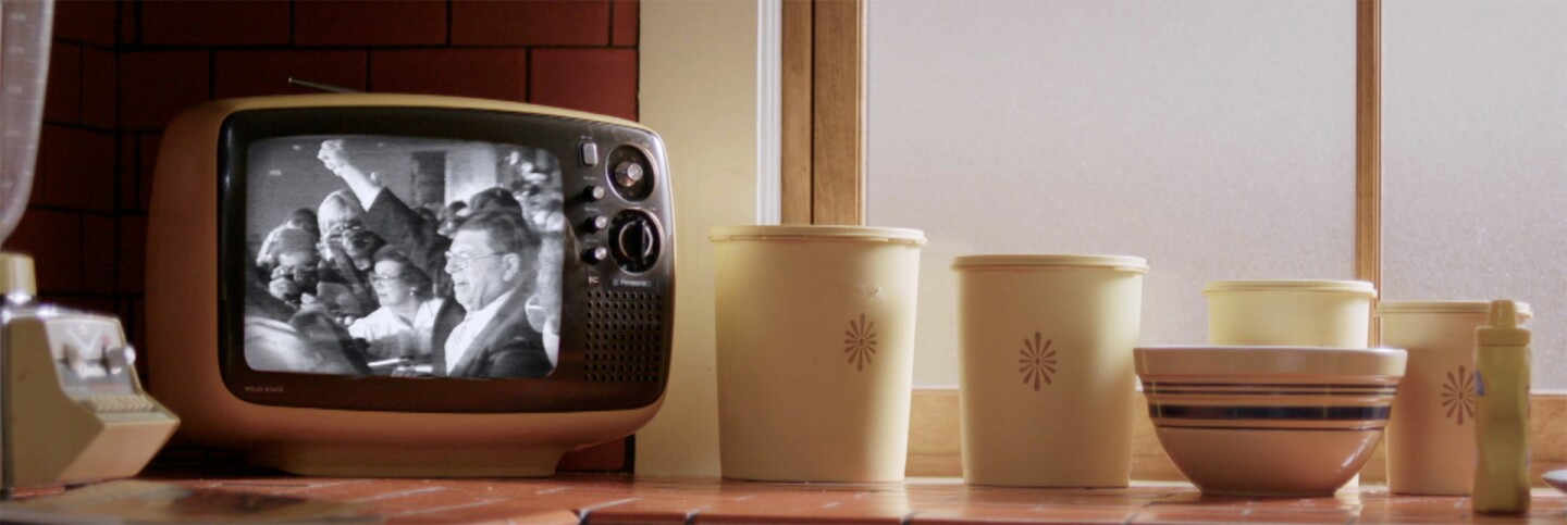 "A shot of Howard Jarvis on a small television screen on a kitchen counter | Still from ""The First Angry Man"""