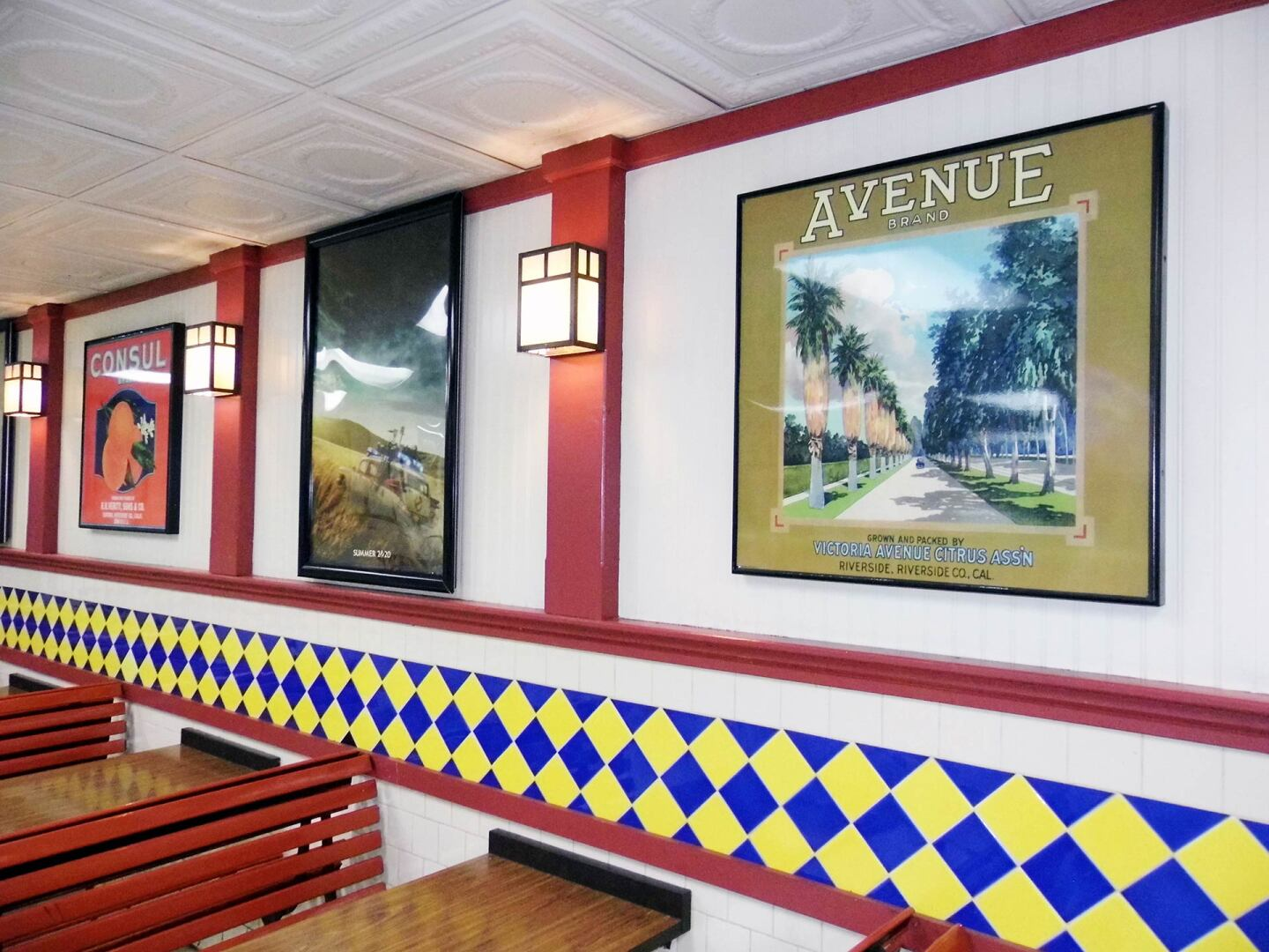 Historic black-and-white photos and reproductions of vintage citrus labels line the walls inside the breeze-blocked snack bar  at the Van Buren Drive-In Theatre | Sandi Hemmerlein