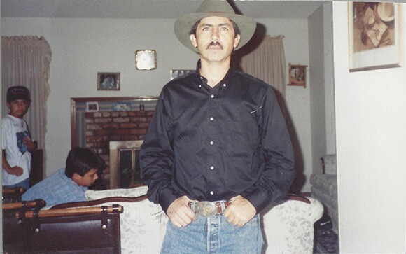 At home in Pomona many years later, Nicholas Guzmán wearing the belt buckle.
