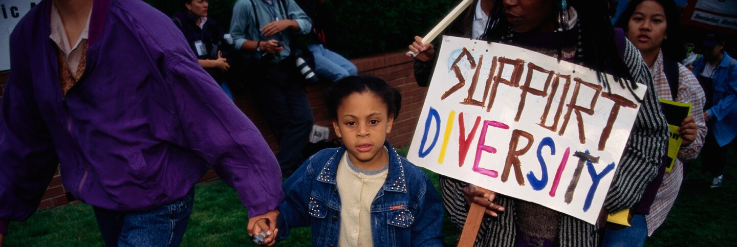 A young girl protests outside the meeting of the University of California's Board of Regents in favor of Affirmative Action October 1995. | David Butow/Corbis via Getty Images