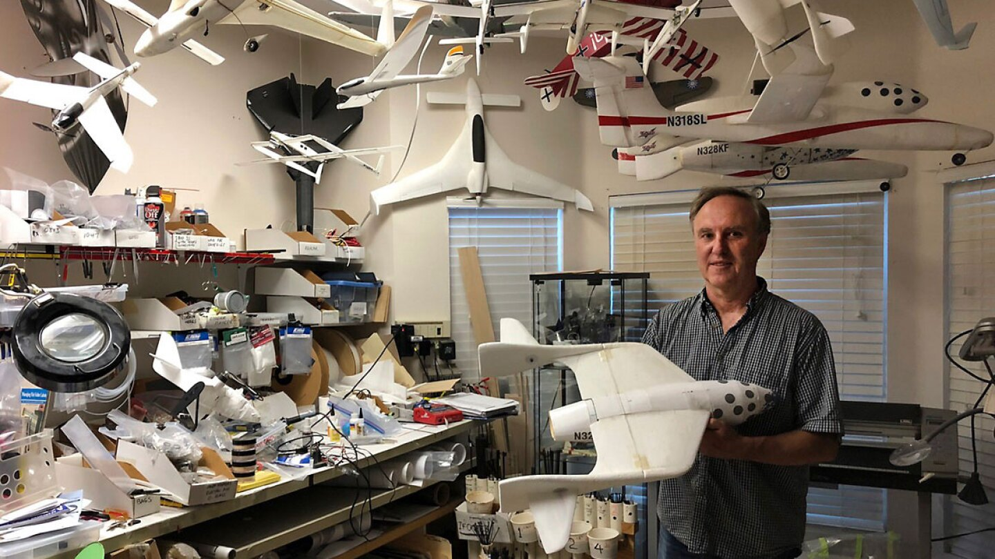 Dan Kreigh, a senior structural engineer at Scaled Composites, displays his scale model of SpaceShipOne. | Daniel Housman