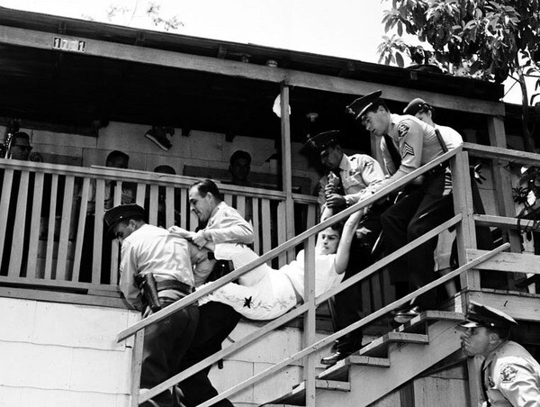 Images similar to this one, of deputies evicting Aurora Arechiga Vargas from her family's house, appeared on the front page of Los Angeles newspapers and in local newscasts. Courtesy of the USC Libraries - Los Angeles Examiner Collection.