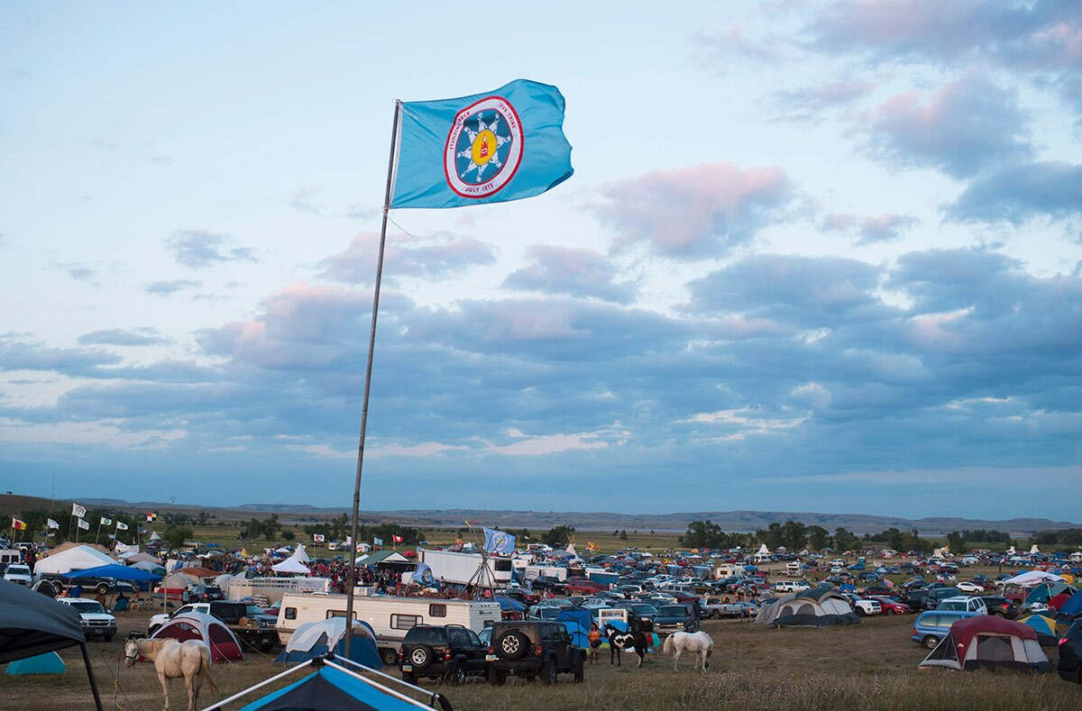A Standing Rock Sioux flag flies over a protest encampment near Cannon Ball, North Dakota where members of the Standing Rock Sioux tribe and their supporters gathered to voice their opposition to the Dakota Access oil Pipeline (DAPL), September 3, 2016.