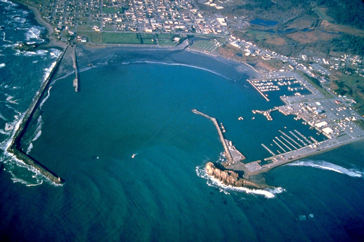 Aerial view of the breakwaters and harbor at Crescent City, Del Norte County, Califiornia,
