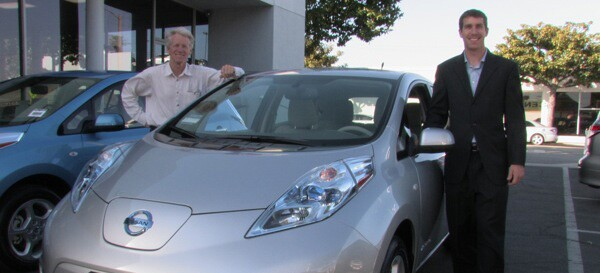 Tim Goodrich, right, stands next to his new electric car with founding member of Plug in America, Paul Scott   Photo via Tim Goodrich