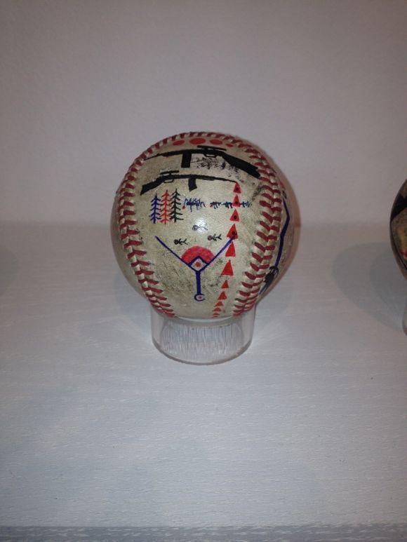Rob Sato creates a memory map on a baseball. | Photo: Liz Ohanesian