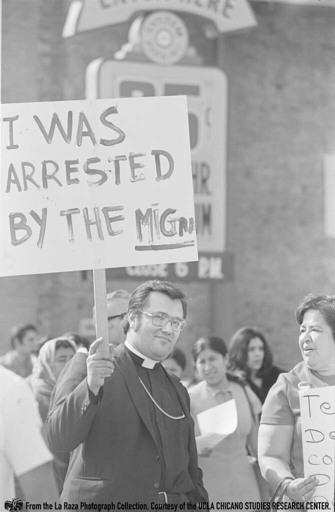 CSRC_LaRaza_B10F3C5_PA_009 Virginia Ram and a priest march against Dixon-ARnett Act in Los Angeles | Pedro Arias, La Raza photograph collection. Courtesy of UCLA Chicano Studies Research Center