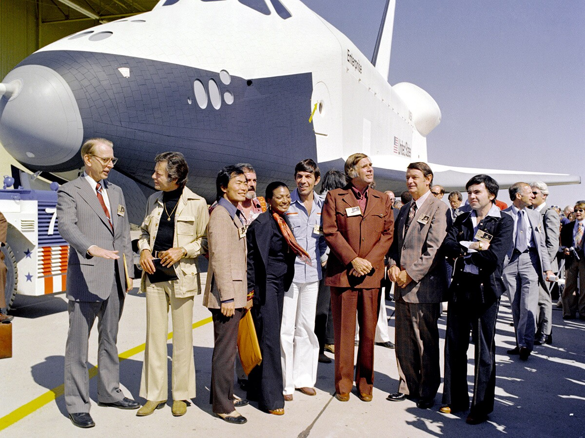 Star Trek creator Gene Roddenberry, the Star Trek cast (with the exception of William Shatner) and NASA administrators attending Enterprise's rollout ceremony in 1976. | NASA/Wikimedia Commons