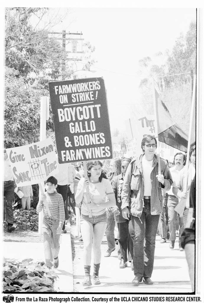 """CSRC_LaRaza_B15F14C1_Staff_012 Protesters demonstrate against President Richard Nixon in the """"Dump Nixon"""" march from Echo Park to MacArthur Park 