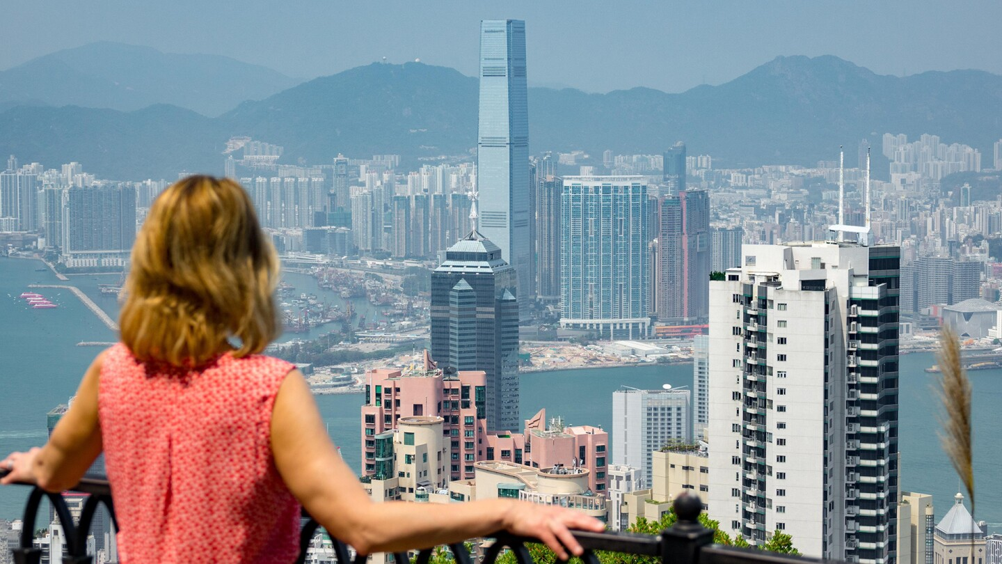 Samantha Brown overlooks the cityscape of Hong Kong.