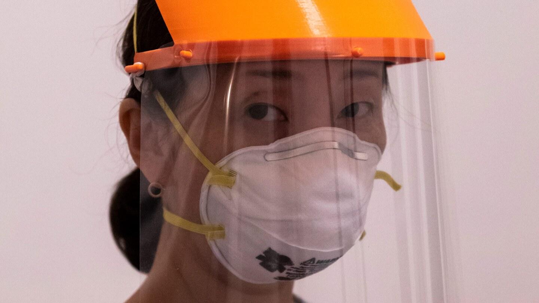 Rieko Takamatsu, art professor Devon Tsuno's wife, wears a face shield made by the 3D PPE Artist Network. | Courtesy 3D PPE Artist Network