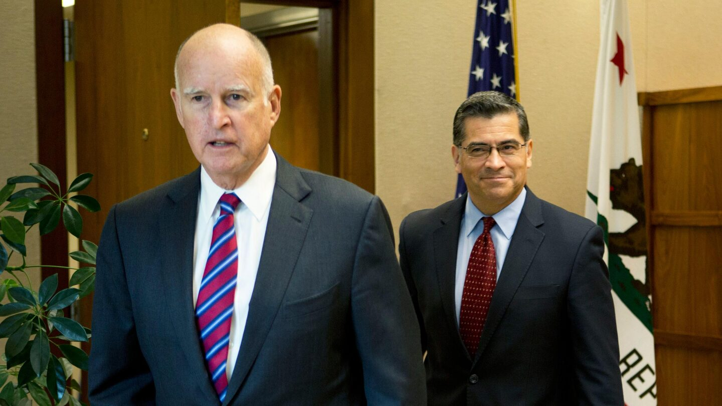 Gov. Jerry Brown with his choice for state attorney general, Xavier Becerra | photo by Steve Yeater for CALmatters