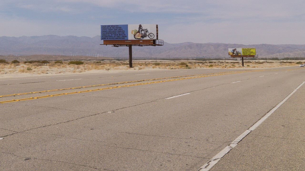 """Xaviera Simmons' """"Because You Know Ultimately We Will Band A Militia"""" is a series of billboards along Gene Autry Trail as part of Desert X 2021."""