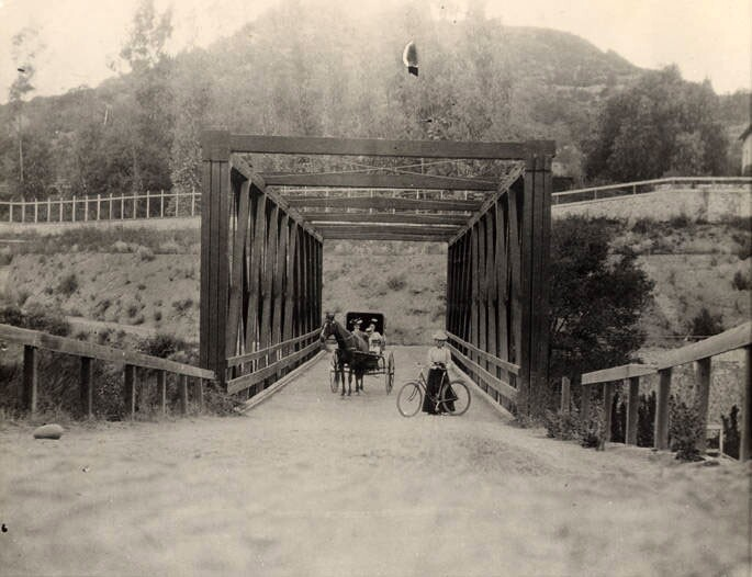 The Scoville Bridge, seen here in 1889, traversed the stream of the Arroyo Seco but still required travelers to descend into the ravine and then climb the opposite bank after crossing. Courtesy of the Pasadena Museum of History.