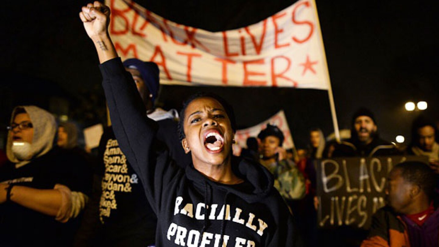A woman protests with members of Black Lives Matter.
