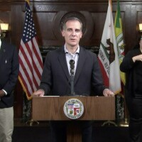 Mayor Eric Garcetti at podium during a press conference on riots on May 30, 2020