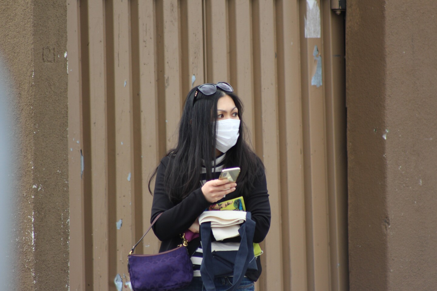 Woman looks to her left wearing a face mask | Karen Foshay