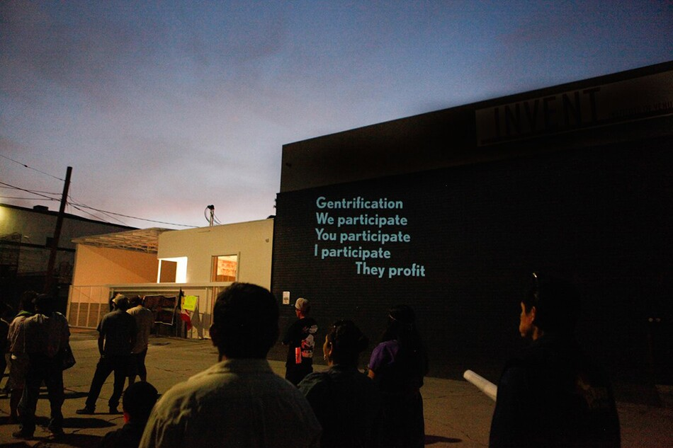Projection of Gentrification Poem on PSSST Wall. | Photo: La Union de Vecinos