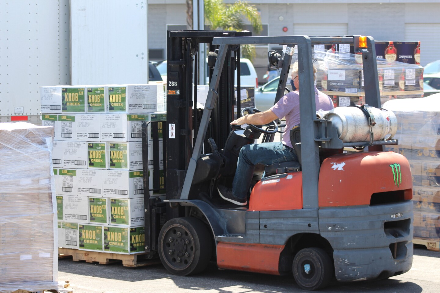 Victor Garcia, a manager with Del Rey Beverage Distributors, unloads a a recent shipment. Garcia says business is up by double digits.   Karen Foshay