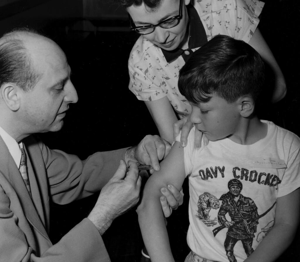 Boy receiving polio vaccine.