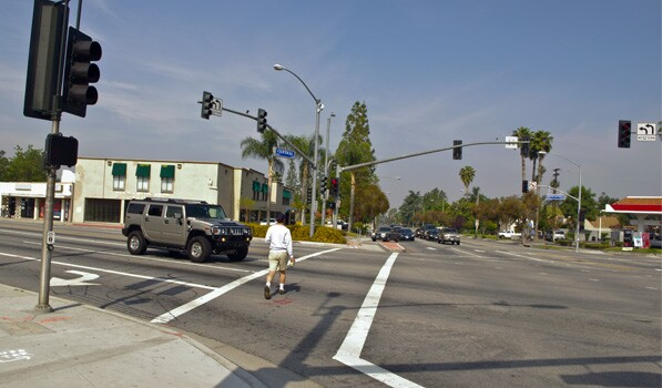 Pedestrian crosses Magnolia Ave in Riverside. Photo: Ed Fuentes