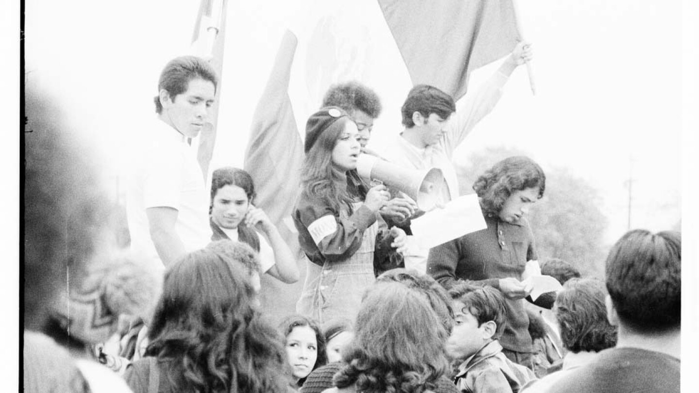 CSRC_LaRaza_B15F10C1_Staff_025 Protesters at Franklin D. Roosevelt Park rally | Maria Marquez Sanchez, La Raza photograph collection. Courtesy of UCLA Chicano Studies Research Center