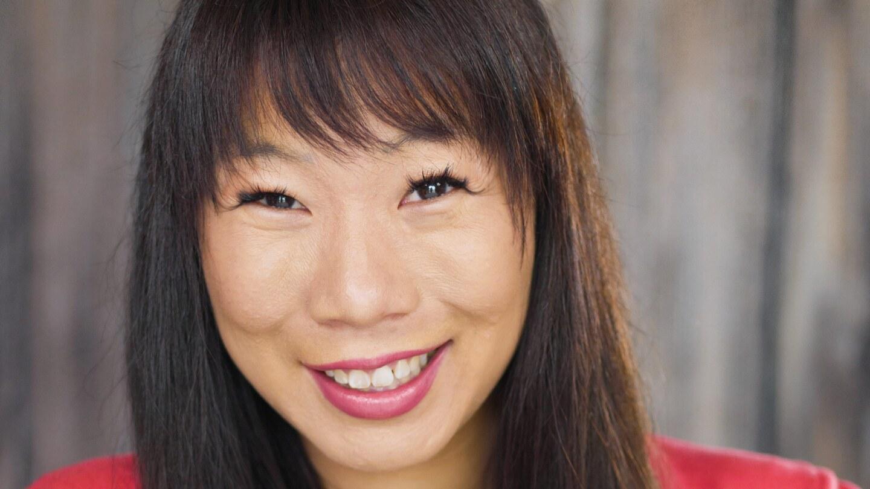 Kristina Wong smiles at the camera.