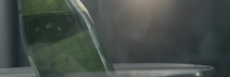 "Green Sequoia Sake bottle | Still from ""The Migrant Kitchen"" Sequoia Sake MKs3"