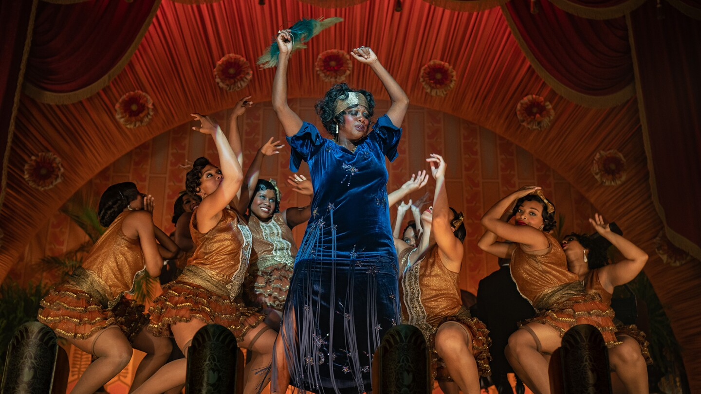 Viola Davis portraying Ma Rainey poses during a performance.