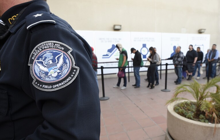 Pedestrians crossing from Mexico into the United States at the Otay Mesa Port of Entry wait in line on Dec. 10, 2015. | Denis Poroy/AP