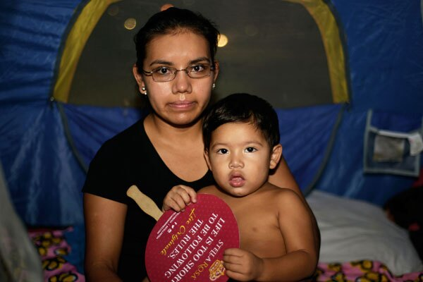 Entire families prepared to camp out throughout the day for much-needed healthcare. I Photo By: Ricardo Palavecino