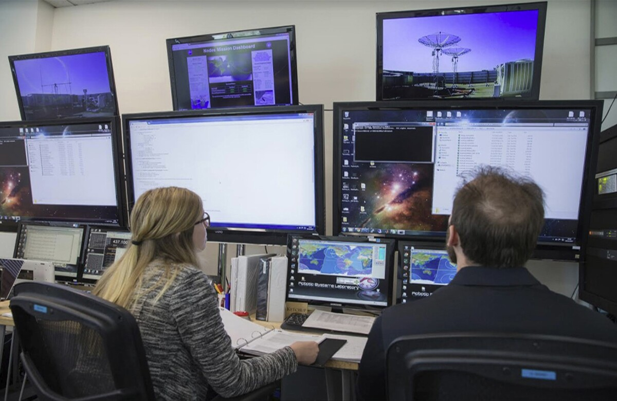 Kayleigh Dobson and recent graduate Leland Taylor in the mission control room at the Robotic Systems Laboratory. | Courtesy of Christopher Kitts