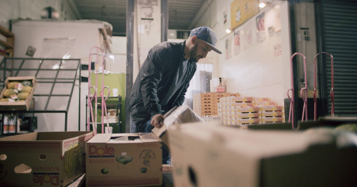 "Carlos working at his family's fruit business | Still from ""Nightshift"""