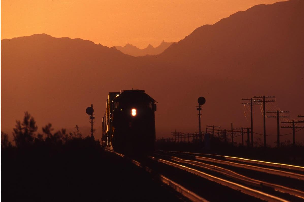 The sunset at Bolo near Amboy makes a perfect backdrop for a Westbound Santa Fe freight train. | Richard Steinheimer
