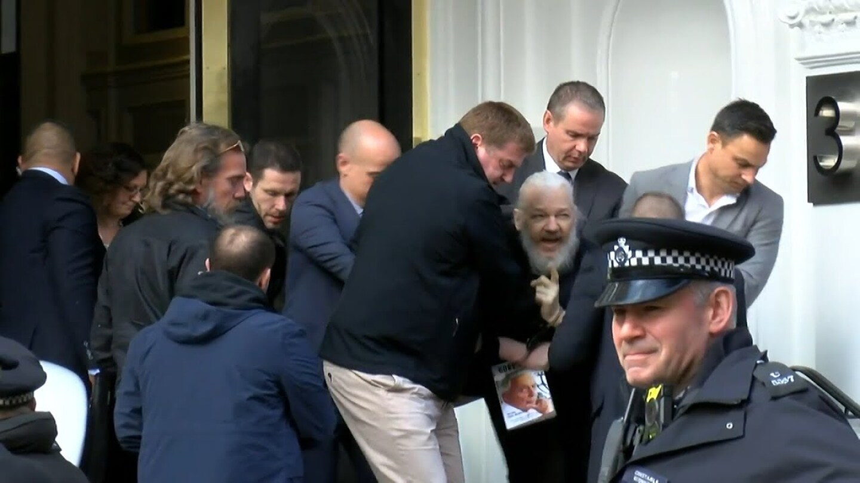 WikiLeaks founder Julian Assange gets arrested. | Still from Democracy Now!
