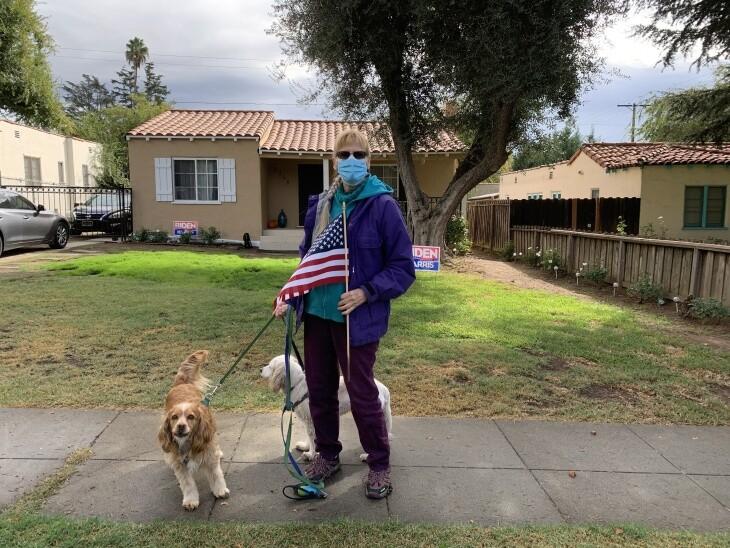 Barbara Wilson walked with the American flag around her Altadena neighborhood after the race was called for Joe Biden. | Josie Huang/LAist