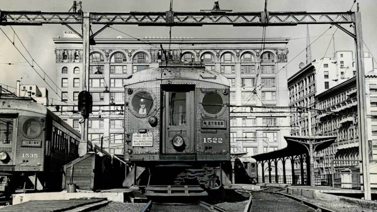A Pacific Electric Red Car leaves the building at 6th and Main Streets | Los Angeles Examiner Photographs Collection, University of Southern California Libraries