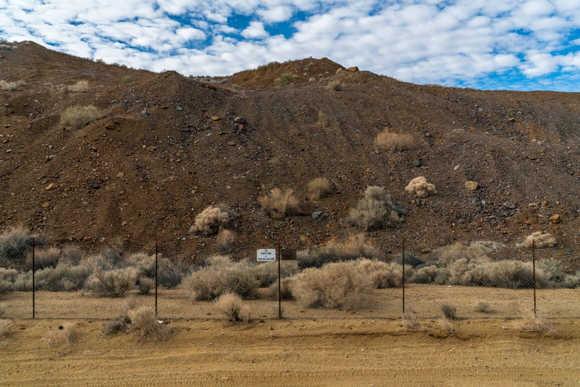 A small section of RMC's spent heap leach pad. Notice how the mountain of ore has been graded to appear more natural.   Kim Stringfellow.